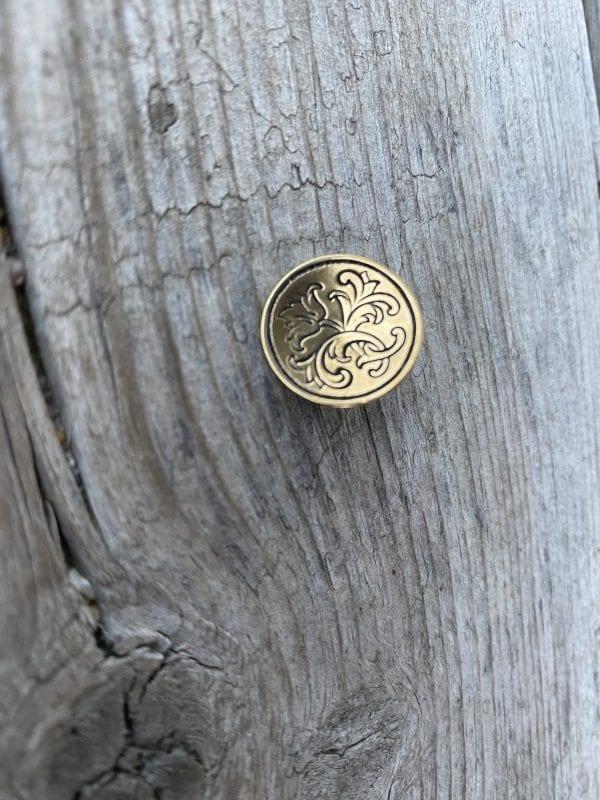 Liten messing knapp til Østerdalsbunad